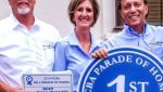 Craig Jennings, Tammy Jennings, Mike Hickman stand with the PCBA Parade of Houses Blue Ribbon for 1st Place Sign
