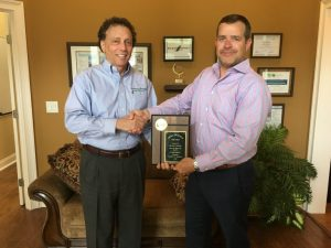 Sean Harper Gives Mike Hickman Small Business Award